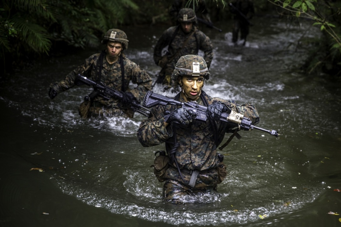 U.S. Marines assigned to 3rd Marine Division navigate through an endurance course during a squad competition at the Jungle Warfare Training Center in Okinawa, Japan, March 18, 2020. The competition was held to evaluate standards-based infantry training.