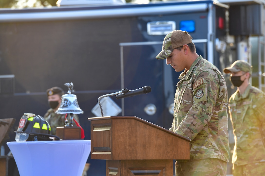 An Airman gives remarks during a ceremony