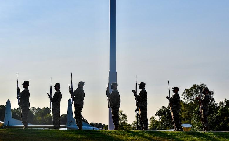 Airmen perform a 21-gun salute