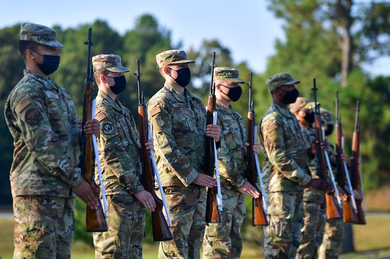 Airmen prepare to perform a 21-gun salute