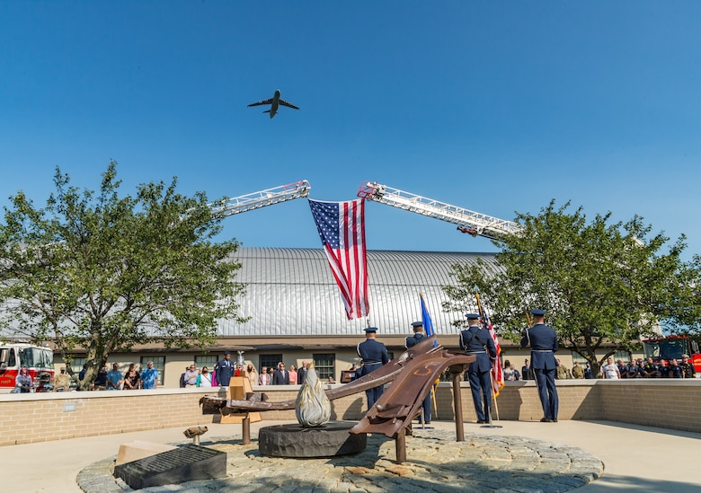 A C-5M Super Galaxy flies over the Air Mobility Command Museum during the 9/11 Remembrance Ceremony on Dover Air Force Base, Delaware, Sept. 11, 2021. The base commemorated  the 20th Anniversary of 9/11 to remember and honor those who perished in the attacks on Sept. 11, 2001. (U.S. Air Force photo by Roland Balik)