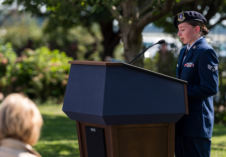 Senior Airman Lindsay Wells, 436th Security Forces Squadron response force member, reads the Security Forces Prayer during the 20th Anniversary 9/11 Remembrance Ceremony held at the Air Mobility Command Museum's 9/11 Memorial on Dover Air Force Base, Delaware, Sept. 11, 2021. Wells read the prayer to honor the 71 law enforcement officers who died while responding to the terrorist attacks on the World Trade Center in New York Sept. 11, 2001.(U.S. Air Force photo by Roland Balik)