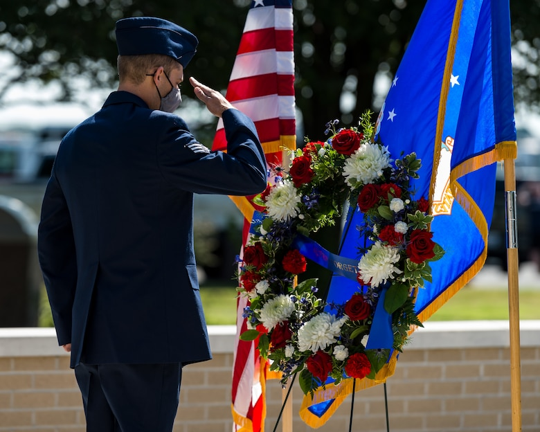 Senior Airman Kyle Spence, 436th Civil Engineer Squadron fire department operator, renders a salute during the 20th Anniversary 9/11  Remembrance Ceremony held at the Air Mobility Command Museum's 9/11 Memorial on Dover Air Force Base, Delaware, Sept. 11, 2021. Spence placed the wreath at the memorial in remembrance for all those who died in the terrorist attacks on the World Trade Center in New York Sept. 11, 2001. (U.S. Air Force photo by Roland Balik)