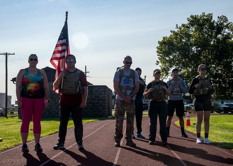 Team Dover members pause at 9:03 a.m. to signify the second World Trade Center Tower being struck during the 9/11 Remembrance Ruck March on Dover Air Force Base, Delaware, Sept. 11, 2021. Units from Team Dover rucked in 30-minute increments for more than 25 hours, remembering and honoring those who perished in the attacks on Sept. 11, 2001. (U.S. Air Force photo by Senior Airman Stephani Barge)