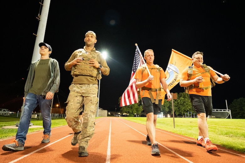 Team Dover members participate in the 9/11 Remembrance Ruck March on Dover Air Force Base, Delaware, Sept. 10, 2021. Units from Team Dover rucked in 30-minute increments for more than 25 hours, remembering and honoring those who perished in the attacks on Sept. 11, 2001. (U.S. Air Force photo by Mauricio Campino)