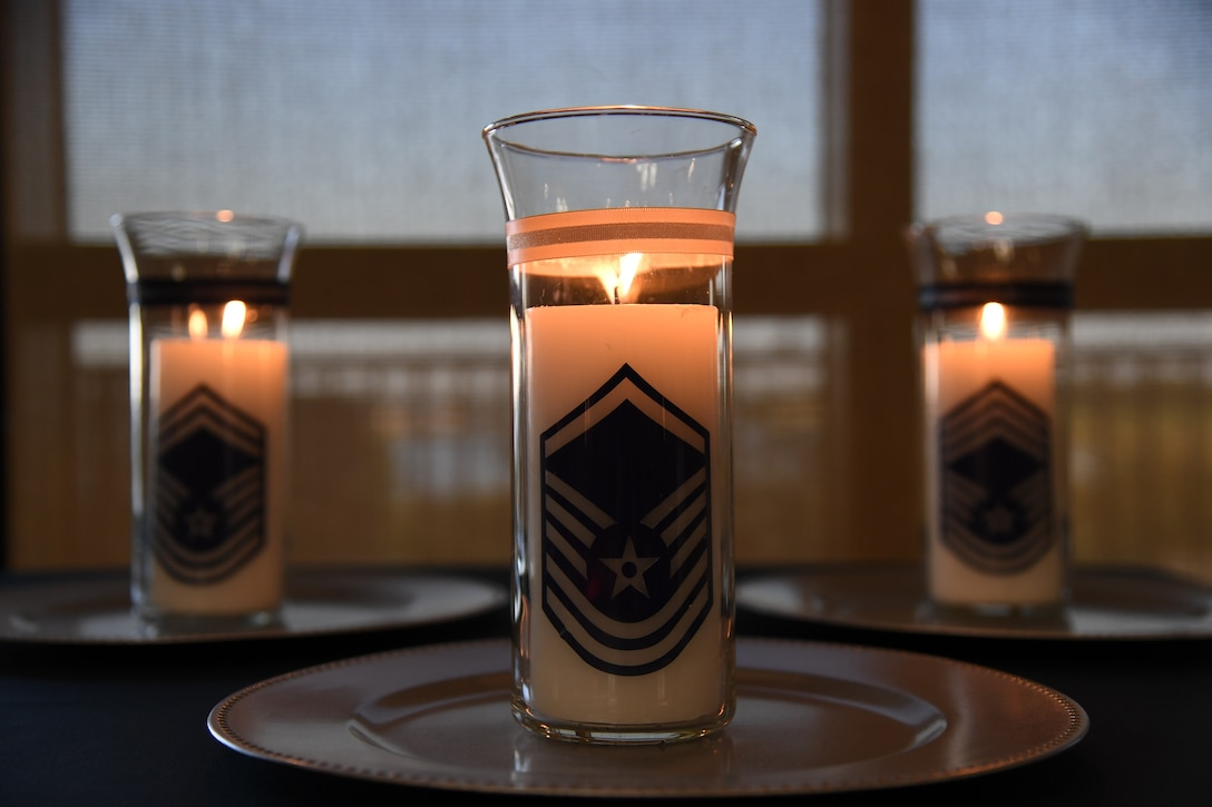 Candles are on display during the Senior NCO Induction Ceremony inside the Bay Breeze Event Center at Keesler Air Force Base, Mississippi, Sept. 10, 2021. More than thirty enlisted members were recognized during the event. (U.S. Air Force photo by Kemberly Groue)