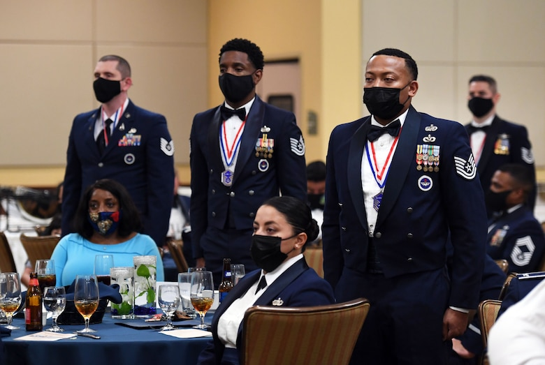 Inductees stand to be recognized during the Senior NCO Induction Ceremony inside the Bay Breeze Event Center at Keesler Air Force Base, Mississippi, Sept. 10, 2021. More than thirty enlisted members were recognized during the event. (U.S. Air Force photo by Kemberly Groue)