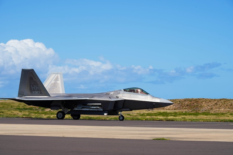 An F-22 Hawaiian Raptor lands during an Agile Combat Employment training exercise at Pacific Missile Range Facility Barking Sands, Hawaii, September 8, 2021.  The ACE concept utilizes Multi-Capable Airmen to refuel, rearm, and perform maintenance to fighter jets ensuring the aircraft are ready to rapidly deploy. (U.S. Air Force photo by Airman 1st Class Makensie Cooper)
