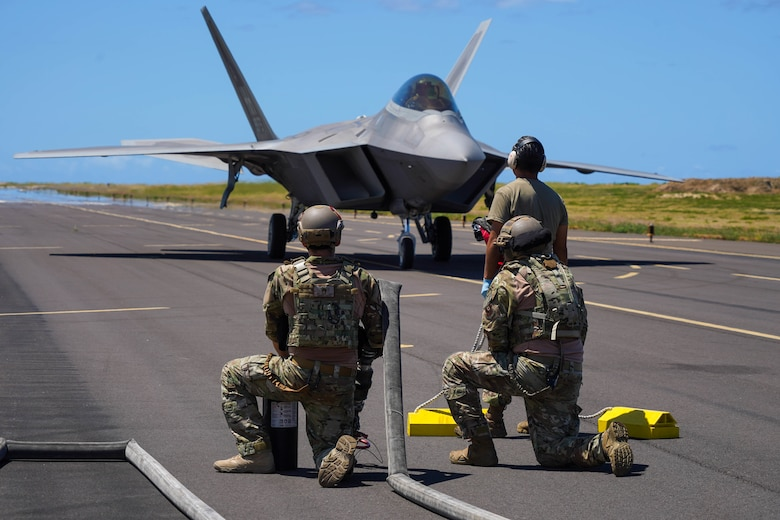 Airmen from the 15th Wing and Hawaiian Air National Guard worked alongside Airmen from the 353d Special Operations Group to conduct static forward area refueling point training during an Agile Combat Employment training exercise at Pacific Missile Range Facility Barking Sands, Hawaii, September 8, 2021. The ACE concept utilizes Multi-Capable Airmen to refuel, rearm, and perform maintenance to fighter jets ensuring the aircraft are ready to rapidly deploy. (U.S. Air Force photo by Airman 1st Class Makensie Cooper)