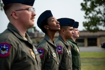 97th Training Squadron students stand at ease during a 9/11 remembrance ceremony at Altus Air Force Base, Oklahoma, Sept. 10, 2021. The ceremony was a precursor to the 97th Air Mobility Wing Remembrance Ceremony and was held to educate generations of younger Airmen on the significance of 9/11. (U.S. Air Force photo by Senior Airman Amanda Lovelace)