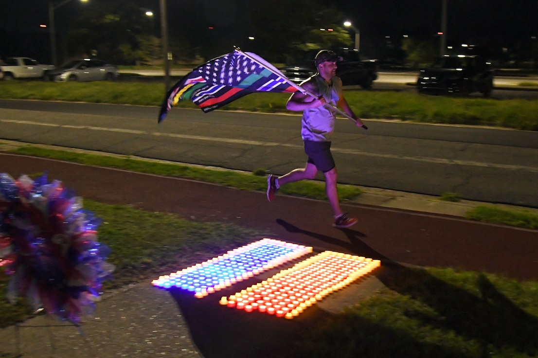 U.S. Air Force Capt. Brian Chapman, 81st Healthcare Operations Squadron internal medicine resident, participates in the 2nd Annual 9/11 Memorial Run at Keesler Air Force Base, Mississippi, Sept. 10, 2021. The 24-hour run honored those who lost their lives during the 9/11 attacks. (U.S. Air Force photo by Kemberly Groue)