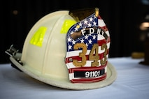 A white firefighter helmet is displayed during a 9/11 remembrance ceremony on Eielson Air Force Base, Alaska, Sept. 11, 2021.