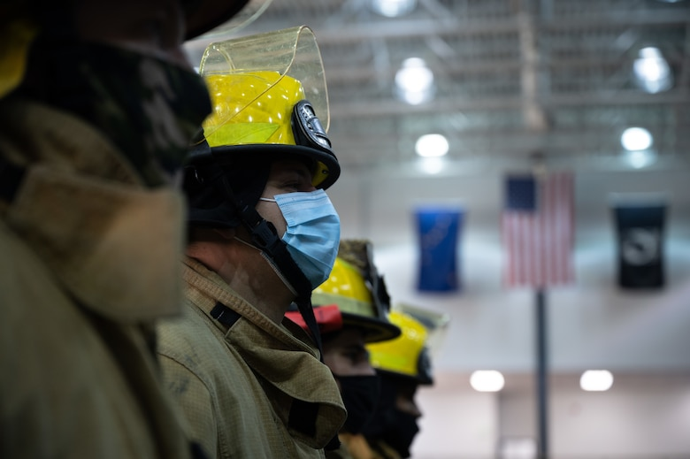 U.S Air Force firefighters assigned to the 354th Civil Engineering Squadron stand in formation during a 9/11 remembrance ceremony on Eielson Air Force Base, Alaska, Sept. 11, 2021.
