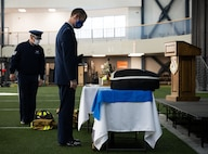 U.S. Air Force Airmen from the 354th Fighter Wing look at 9/11 memorabilia during a remembrance ceremony on Eielson Air Force Base, Alaska, Sept. 11, 2021.