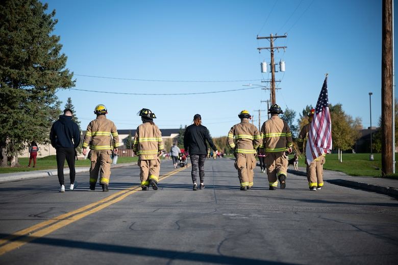 U.S. Air Force Airmen assigned to the 354th Fighter Wing and their families participate in a 9/11 remembrance 5k march on Eielson Air Force Base, Alaska, Sept. 11, 2021.