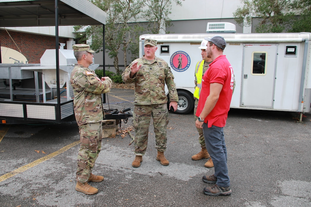 Capt. Aaron Miley and Michael Maaninen, both from Honolulu District, talk to Army Reserve members installing a temporary power generator at  Nicholls State University in Thibodaux, LA. Miley and Maaninen are supporting the Federal Emergency Management Agency (FEMA) assigned Temporary Emergency Power Mission as part of the U.S. Army Corps of Engineers Hurricane Recovery mission in southeastern Louisiana.