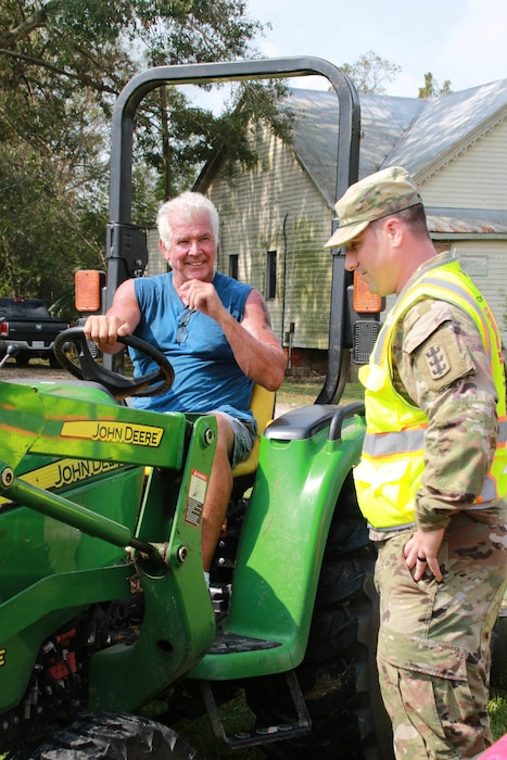 Capt. Aaron Miley from Honolulu District talks to a homeowner, Nathan Mitch of Donaldsonville, LA. Miley is in support of he Federal Emergency Management Agency (FEMA) assigned Temporary Emergency Power Mission as part of the U.S. Army Corps of Engineers Hurricane Recovery mission in southeastern Louisiana.