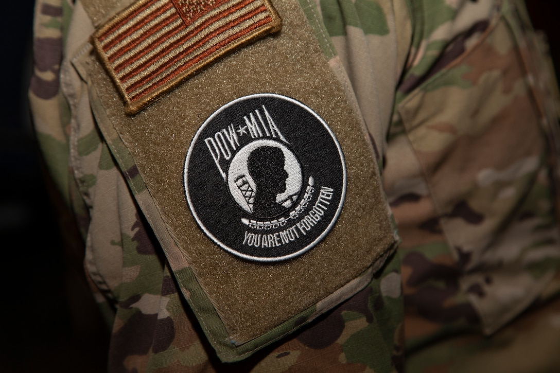 In honor of the sacrifices made by Prisoners of War and Missing in Action, Brig. Gen. Matthew Higer, 412th Test Wing and base commander, has authorized the temporary wear of the POW/MIA patch on Airmen's uniforms in place of their unit patch. The authorization will last until the end of POW/MIA Recognition Day, Sept. 17. (Air Force photo by Clay Cupit)