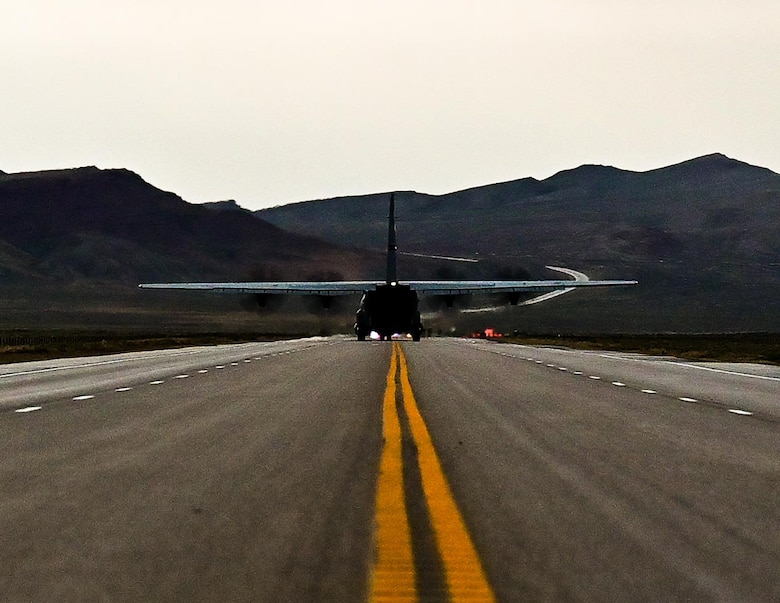 Cargo aircraft lifting off of a highway