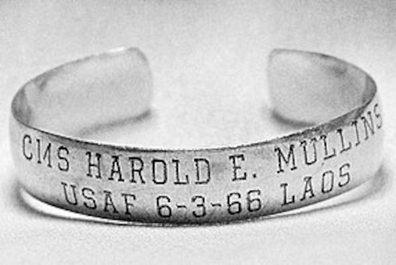 A bracelet is engraved with the name of Air Force Chief Master Sgt. Harold Mullins, the date he went missing and the location.