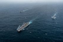 ARABIAN SEA (September 13, 2021) Amphibious assault ship USS Essex (LHD 2), middle, amphibious dock landing ship USS Pearl Harbor (LSD 52), left, and amphibious transport dock ship USS Portland (LPD 27), transit the Arabian Sea, Sept. 13. The Essex Amphibious Ready Group is deployed to the U.S. 5th Fleet area of operations to ensure maritime stability and security in the Central Region, connecting the Mediterranean and the Pacific through the western Indian Ocean and three strategic choke points.