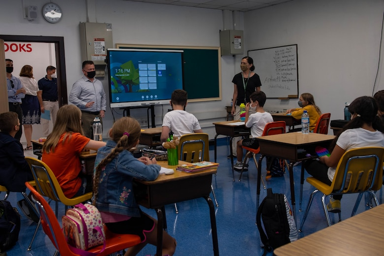 Air Force officer meeting classroom of students at a DOD facility