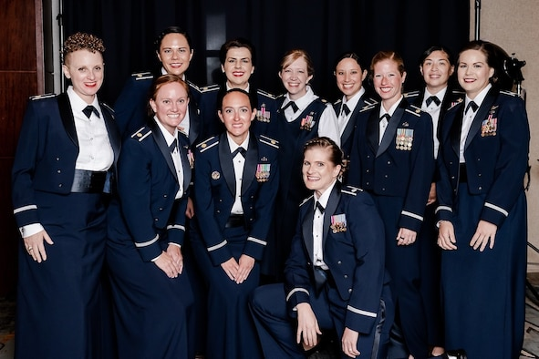 Group of female Airmen graduating in service dress