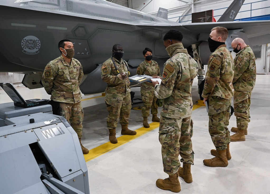 Weapons Standardization crew members evaluating  a load crew