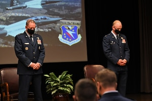 U.S. Air Force Lt. Gen. James Hecker, Air University Commander and President, and Col. Seth Graham, 14th Flying Training Wing Commander, bow their heads in prayer during the graduation ceremony of Specialized Undergraduate Pilot Training Class 21-15, Sept. 10, 2021, on Columbus Air Force Base, Miss. Hecker was commissioned in the Air Force in 1989 after graduating from the U.S. Air Force Academy and has commanded at the squadron, group, wing and numbered Air Force levels prior to his current position. (U.S. Air Force photo by Senior Airman Jake Jacobsen)