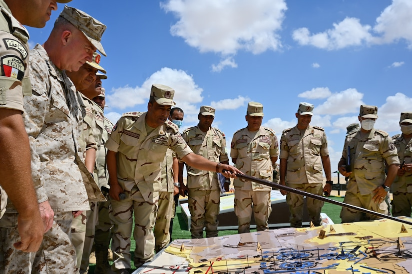 General Kenneth F. McKenzie, Jr., Commander, United States Central Command (USCENTCOM), receives a brief given by U.S., and Coalition forces participating in the Field Training exercise (FTX) during Bright Star 21 (BS21) at Mohamed Naguib Military Base (MNMB), Egypt, Sept. 11, 2021. BS21 is a multilateral exercise hosted by the Arab Republic of Egypt with support from USCENTCOM. The exercise contains three key events: a Command-Post Exercise (CPX), FTX, and a Senior Leader Seminar. The purpose of BS21 is to promote and enhance regional security and cooperation, promote interoperability in irregular warfare against 21st Century hybrid threat scenarios, and to enhance interoperability throughout the full range of military operations. (U.S. Army photo by Spc. Amber Cobena)