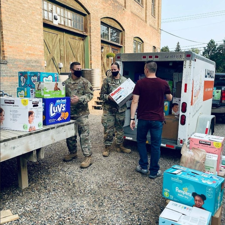 SSgt. Andrea Payne posing with the diapers she collected for the diaper drive.