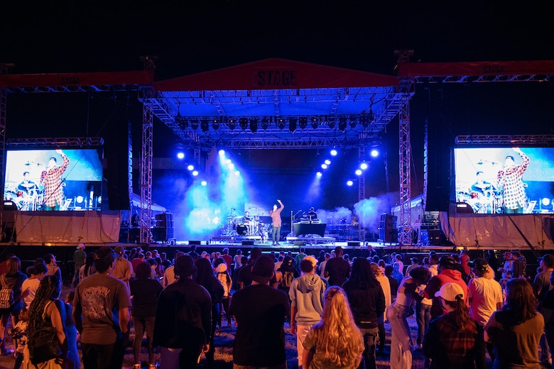 Hip-hop artist Lecrae performs before a crowd of spectators at the End of Summer Concert on Dover Air Force Base, Delaware, Sept. 10, 2021. The free concert was open to all Team Dover Airmen and their families. (U.S. Air Force photo by Mauricio Campino)