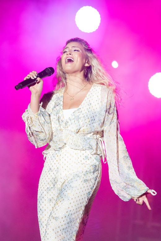 Gospel singer Tori Kelly performs before a crowd of spectators at the End of Summer Concert on Dover Air Force Base, Delaware, Sept. 10, 2021. The concert also featured hip-hop artist Lecrae and was the base's first open air concert since 2018. (U.S. Air Force photo by Mauricio Campino)