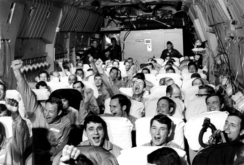 Released American POWs cheer once the reach safe airspace. (Courtesy photo)