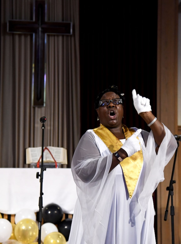 """Carla Heard, Gospel Choir member, performs a ministry song in sign language during the 50th Gospel Worship Service Anniversary inside Larcher Chapel at Keesler Air Force Base, Mississippi, Sept. 12, 2021. The service's theme was """"Growing Stronger, Growing Deeper, Reaching Higher."""" (U.S. Air Force photo by Kemberly Groue)"""