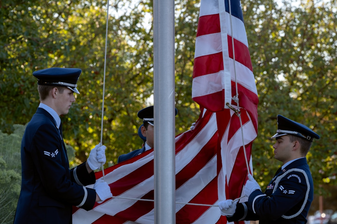 High Frontier Honor Guard Ceremonial Guardsman raise the American flag.