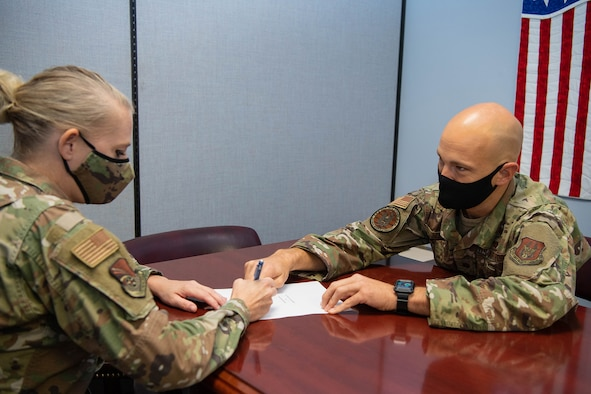 Maj. Jonathon Hoover, 434th Air Refueling Wing staff judge advocate general, assists Tech. Sgt. Jami Lancette, 434th Air Refueling Wing public affairs specialist, in preparing her will on Sept. 13, 2021. The Grissom legal office provides services such as wills and powers of attorney to eligible Airmen so that they can keep their affairs in order in case they ever have to deploy. (U.S. Air Force photo by Master Sgt. Rachel Barton)