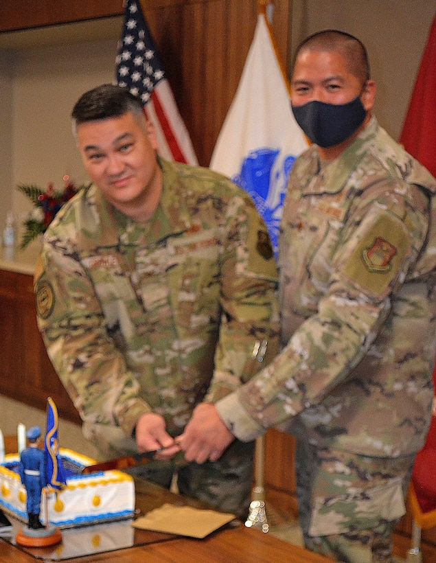 Air Force Col. Adrian Crowley, left, and Maj. Francisco Boral cut a cake in recognition of the Air Force's 74th birthday September 14, 2021 in Philadelphia.