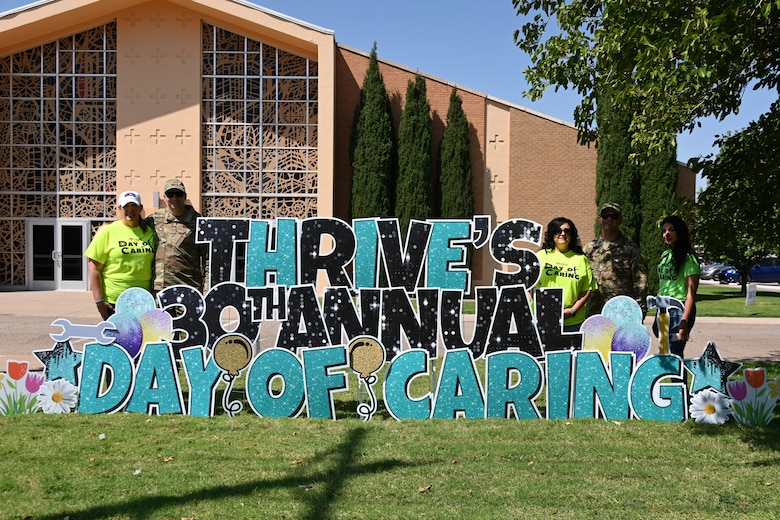 49th Wing leadership and Thrive's leading members pose for a picture in front of Thrive's 30th Annual Day of Caring sign, Sept. 10, 2021, at Alamogordo, New Mexico. Thrive in Southern New Mexico is a non-profit organization in charge of Day of Caring. (U.S. Air Force photo by Airman 1st Class Jessica Sanchez-Chen)