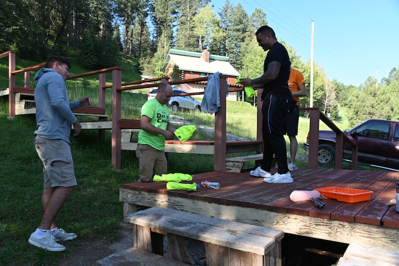 Day of Caring volunteers from Holloman Air Force Base, New Mexico, receive complementary T-Shirts during the 30th annual Day of Caring, Sept. 10, 2021, in Cloudcroft, New Mexico. A total of 342 volunteers participated in the event, the majority coming from the Holloman community, including active duty, dependents, and retirees. (U.S. Air Force photo by Airman 1st Class Jessica Sanchez-Chen)