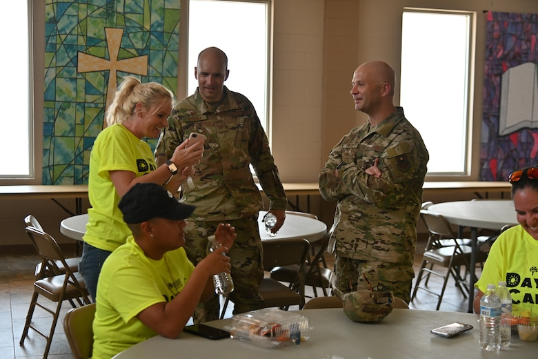 Col. Ryan Keeney, 49th Wing commander, and Chief Master Sgt. Thomas Temple, 49th Wing command chief, speak with Day of Caring volunteers, Sept. 10, 2021, at Alamogordo, New Mexico. Hundreds of Holloman Airmen volunteered for the 30th annual Day of Caring. (U.S. Air Force photo by Airman 1st Class Jessica Sanchez-Chen)