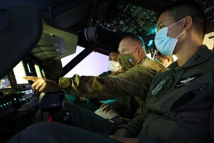 Chief Warrant Officer 4 Ryan Kennedy, a UH-60 Black Hawk helicopter pilot with the 96th Aviation Troop Command, Washington Army National Guard, trains with his Royal Thai Army counterparts in a Black Hawk simulator, Aug. 31, 2021, at Joint Base Lewis-McChord. The exchange was part of the State Partnership Program, which pairs a state or territory's National Guard with a partner nation to enhance security cooperation around the globe.