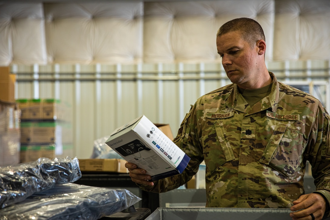 An Expeditionary Medical Support System Airman attached to Task Force-Holloman organizes medical supplies in support of Operation Allies Welcome at Holloman Air Force Base, New Mexico, Sept. 10, 2021. The Department of Defense, through U.S. Northern Command, and in support of the Department of State and Department of Homeland Security, is providing transportation, temporary housing, medical screening, and general support for at least 50,000 Afghan evacuees at suitable facilities, in permanent or temporary structures, as quickly as possible. This initiative provides Afghan evacuees essential support at secure locations outside Afghanistan. (U.S. Army photo by Pfc. Anthony Sanchez)