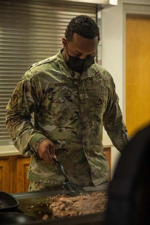 Senior Master Sgt. Aaron Waddy, Task Force-Holloman first sergeant, prepares breakfast for the Airmen working at Aman Omid Village in Holloman Air Force Base, New Mexico on Sept. 13, 2021. The Department of Defense, through U.S. Northern Command, and in support of the Department of State and Department of Homeland Security, is providing transportation, temporary housing, medical screening, and general support for at least 50,000 Afghan evacuees at suitable facilities, in permanent or temporary structures, as quickly as possible. This initiative provides Afghan evacuees essential support at secure locations outside Afghanistan. (U.S. Army photo by Pfc. Anthony Sanchez)
