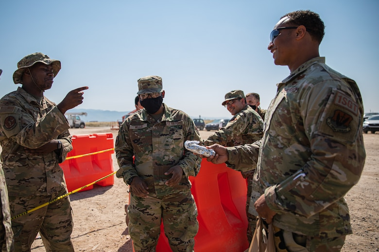 Senior Master Sgt. Aaron Waddy, Task Force-Holloman first sergeant, brings breakfast to Airmen working at Aman Omid Village in Holloman Air Force Base, New Mexico, Sept. 13, 2021. The Department of Defense, through U.S. Northern Command, and in support of the Department of State and Department of Homeland Security, is providing transportation, temporary housing, medical screening, and general support for at least 50,000 Afghan evacuees at suitable facilities, in permanent or temporary structures, as quickly as possible. This initiative provides Afghan evacuees essential support at secure locations outside Afghanistan.(U.S. Army photo by Pfc. Anthony Sanchez)