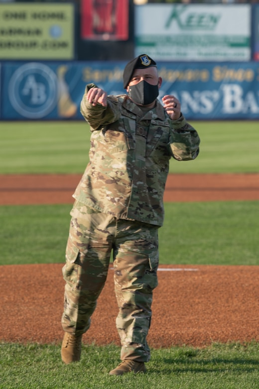 Chief Master Sgt. Eddie Ray, 436th Mission Support Group superintendent, throws the first pitch before a baseball game at Daniel S. Frawley Stadium in Wilmington, Delaware, Sept. 11, 2021. The pre-game ceremony featured a moment of silence remembering those who perished during the 9/11 terrorist attacks. (U.S. Air Force photo by Mauricio Campino)