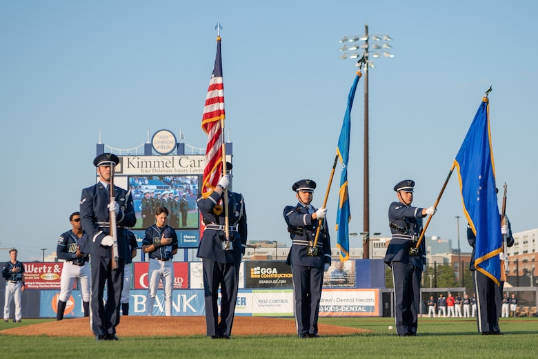 The Dover Air Force Base Honor Guard presents the colors during the national anthem at Daniel S. Frawley Stadium in Wilmington, Delaware, Sept. 11, 2021. The pre-game ceremony featured a moment of silence remembering those who perished during the 9/11 terrorist attacks. (U.S. Air Force photo by Mauricio Campino)