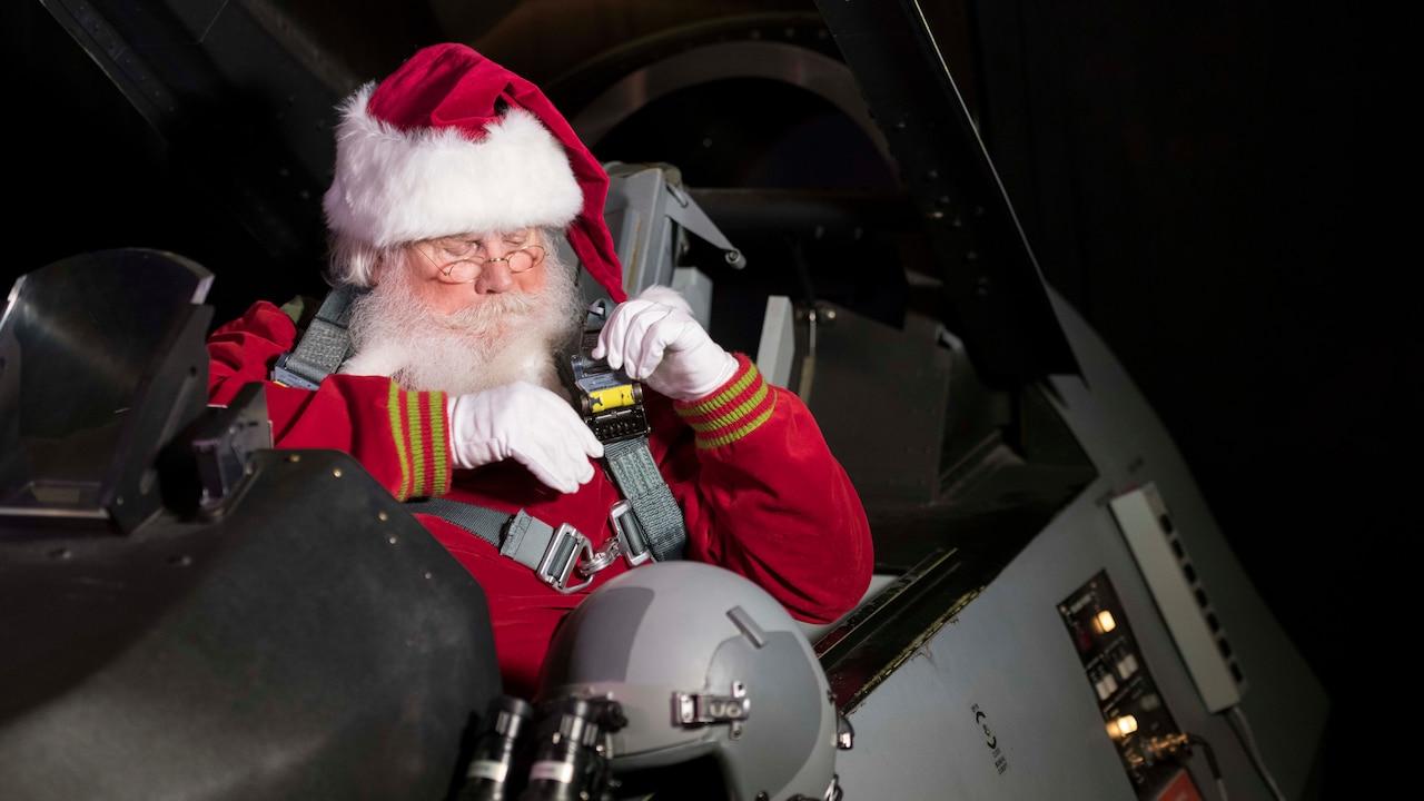 Santa Claus straps into a jet cockpit.