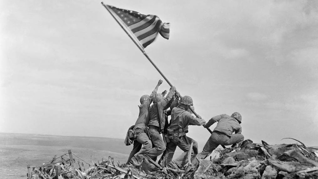 Image of troops placing flag at Iwo Jima