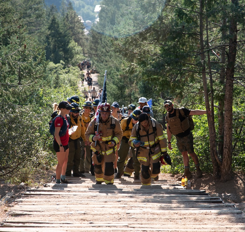 MANITOU SPRINGS, Colo. –Firefighters climb the steps of the Manitou Incline in Manitou Springs, Colorado, on the 20th Anniversary of 9/11, Sept. 11, 2021. The firefighters have traditionally carried up the U.S. flag along with a flag with all the names of first responders who lost their lives in the Sept. 11 attacks. (U.S. Space Force photo by Staff Sgt. Alexandra M. Longfellow)